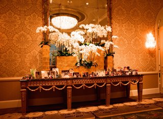 table-of-family-photographs-at-wedding-reception