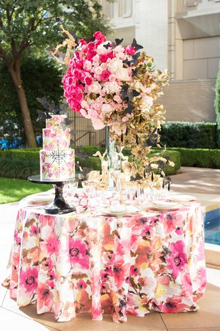 white-cake-with-pink-flower-design-and-black-jewels-black-butterflies-floral-linen-rose-centerpiece
