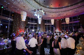 guests-dancing-and-having-fun-on-couples-excitingly-lit-dance-floor-at-their-reception