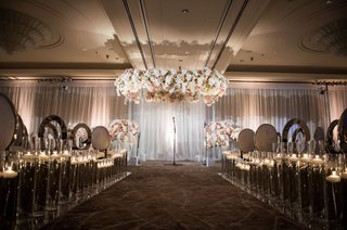 ballroom-jewish-wedding-ceremony-at-country-club-white-drapery-silver-chrome-chairs-no-aisle-runner