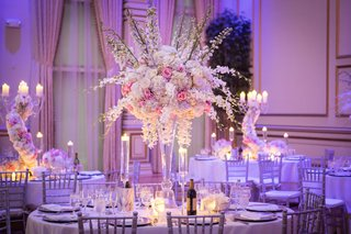 ashley-alexiss-wedding-reception-tall-centerpiece-white-pink-flowers-silver-chairs-candles-drapes