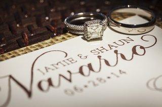 platinum-engagment-ring-with-princess-cut-diamond-halo-diamond-band-grooms-platinum-wedding-ring