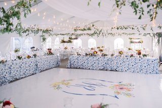 A Charming Fete Blue and White Reception watercolor design on dance floor