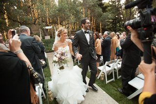 couple-exiting-alfresco-ceremony-with-large-oak-tree