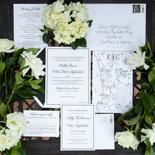 classic wedding invitation suite with custom map and calligraphy black white color palette