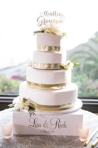 wedding-cake-from-gelsons-four-tiered-gold-ribbon-at-base-of-each-layer-white-frosting