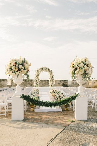 outdoor-wedding-ceremony-old-church-white-flowers-greenery-orchid-colombia-national-flower