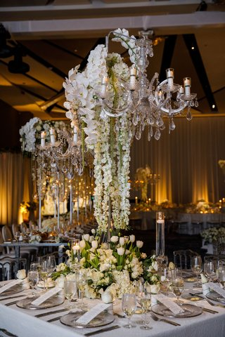 wedding-reception-square-table-sequin-linen-low-flowers-white-hydrangea-rose-tulip-tall-chandelier