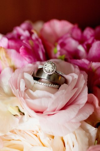 wedding-band-diamond-wedding-band-and-diamond-halo-engagement-ring-on-pink-flowers