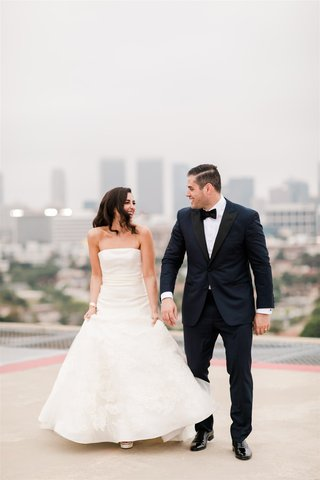 wedding photo of bride and groom in los angeles beverly hills vera wang wedding dress tuxedo