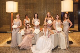 bride in plunging neckline berta wedding dress with bridesmaids mismatch dresses metallic design