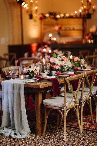 fall-wedding-inspiration-velvet-burgundy-napkins-peach-white-pink-flowers-sheer-grey-table-runner