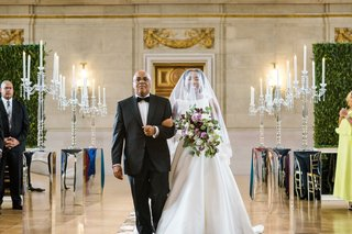 wedding ceremony bride walking down aisle with father of bride a line gown from wedding atelier
