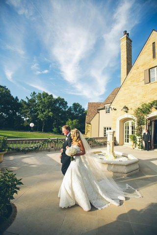 bride-walking-with-dad-to-outdoor-ceremony