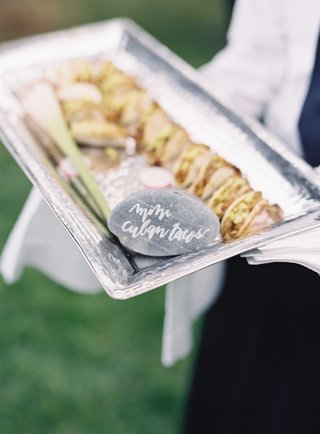 silver-tray-with-miniature-cuban-tacos-appetizer-hors-doeuvre-with-river-rock-calligraphy-sign