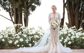 bride-in-marchesa-wedding-dress-long-sleeves-v-neck-mermaid-floral-appliques-tulle-train