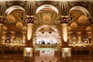wedding-reception-arch-live-band-stage-dance-floor-gold-details-white-flowers