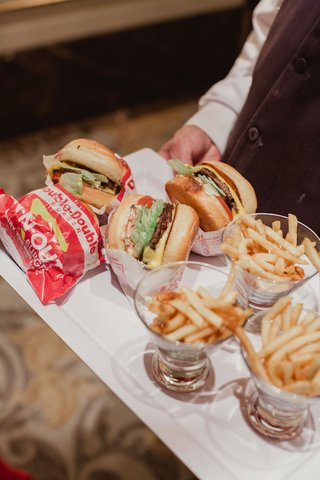 wedding-reception-french-fries-in-glass-cups-with-double-double-burgers-on-tray-wedding-late-night