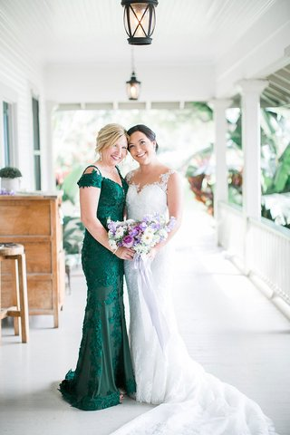 bride-in-lace-illusion-wedding-dress-with-mother-in-dark-green-off-shoulder-evening-gown