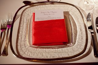 glass-plate-with-menu-card-inside-red-napkin
