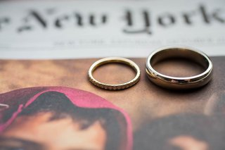 brides-gold-diamond-wedding-ring-and-grooms-platinum-wedding-ring-on-new-york-times
