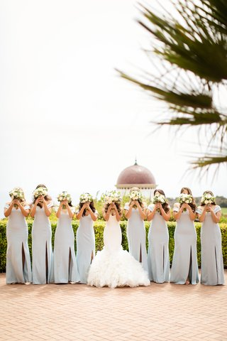 bride-in-ines-di-santo-bridesmaids-in-light-blue-dessy-bouquets-over-faces-pose
