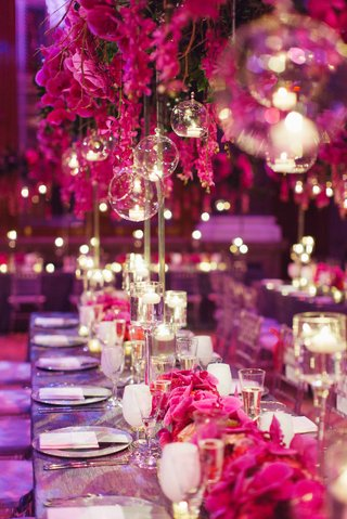 silver-long-reception-table-with-pink-orchid-centerpiece-and-suspended-glass-orbs-filled-with-candle