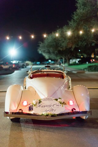 happily-ever-after-with-white-flowers-greenery-classic-convertible-getaway-car-just-married-wedding