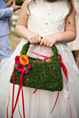 wedding-ceremony-flower-girl-in-ball-gown-with-mosss-handbag-purse-and-basket-with-pink-ribbon