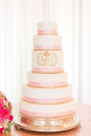 wedding-cake-white-fondant-pink-ribbon-gold-jewels-and-gold-monogram-crest