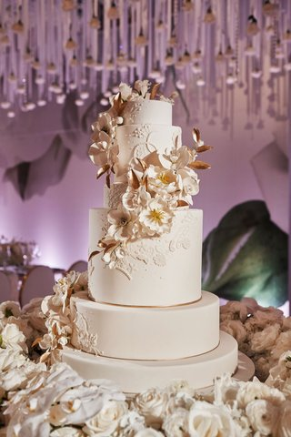 ron-ben-israel-wedding-cake-white-and-gold-with-sugar-flowers-cascading-down-tiers