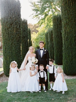 bride-in-martina-liana-ball-gown-flower-girls-with-bows-in-their-hair-ring-bearers-with-knee-socks