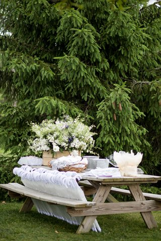 outdoor-wedding-ceremony-wood-picnic-table-with-pashmina-throws-in-baskets-umbrella-parasols-more