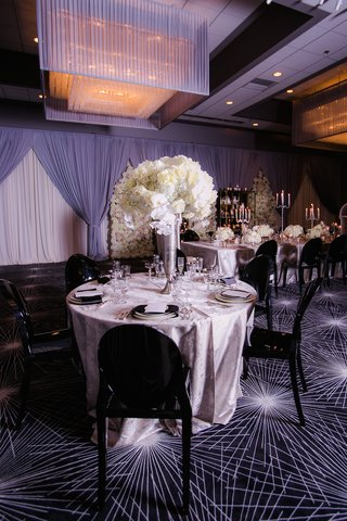 wedding-reception-at-the-estate-by-gene-georgetti-with-black-ghost-chairs-silver-linens