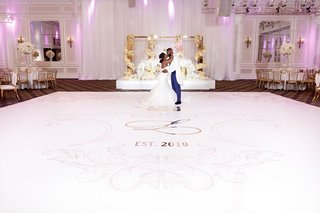 wedding-reception-white-dance-floor-pink-monogram-and-gold-details-in-front-of-sweetheart-table