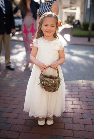 white-flower-girl-dress-short-sleeves-with-slippers-flower-in-hair-twig-and-greenery-basket