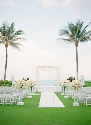 white-chairs-and-aisle-leading-to-wedding-canopy
