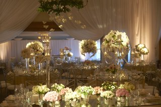 mirrored-tables-topped-with-lush-floral-arrangements