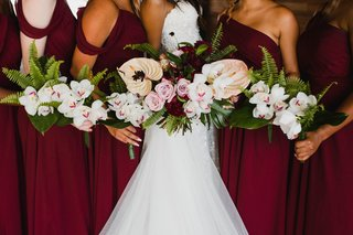bridesmaids-bouquets-with-ferns-orchids-tropical-leaves