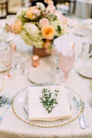 wedding-reception-gold-bead-charger-plate-pink-glassware-goblet-orange-pink-flowers-greenery