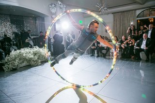 wedding-reception-after-party-entertainment-led-wheel-spin-performer-acrobatics