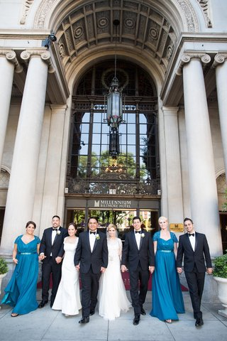 bride-in-a-jenny-packham-dress-groom-and-groomsmen-in-tuxedos-and-bridesmaids-in-long-blue-dresses