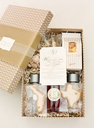 wedding-welcome-box-full-of-cookies-garrets-popcorn-water-and-rose-wine