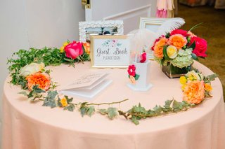 bridal-shower-pink-round-table-garland-flowers-pencil-holder-guest-book-sign-and-framed-photos