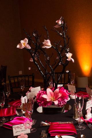 black-branch-centerpiece-with-pink-orchid-and-crystal-decorations