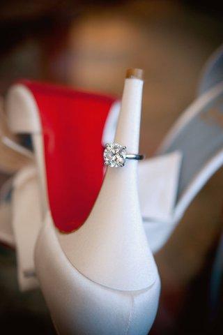 round-cut-diamond-engagement-ring-on-christian-louboutin-heel