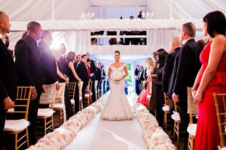 megan-wollover-walking-down-the-original-runner-co-aisle-runner-with-white-and-pink-flowers