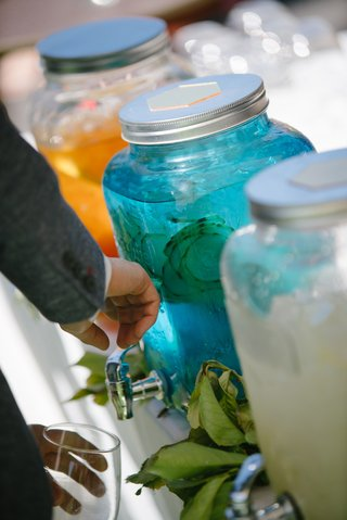 guest-takes-cucumber-infused-water-from-blue-container