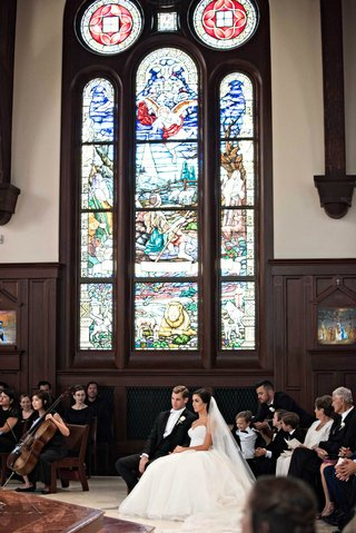 catholic-church-wedding-with-intricate-stained-glass-windows