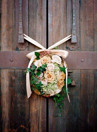 barrel-room-door-flowers-with-orange-and-pink-roses